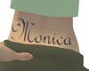 Monica tatoo under back